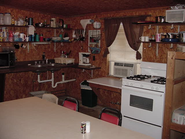 ... Of One Of The Hunting Cabins At The Dalmon Camp. This View Shows The  Kitchen Area End. All Cabins Come Equipped With A Refrigerator, Microwave,  Stove, ...